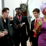 From left to right: Damascus, Doctor FUNdamental, Liam Oakley-Brown, Morpho, and Medusa at a cocktail party.